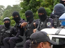 Masked persons may or may not be members of the official police force here in Mexico. Numerous crimes are committed daily by those dressed much like those pictured here.