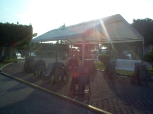 Funeral homes come and set up a tent like this one to shade the mourners.