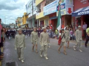 Each school has an esculta (honor guard) in the parade.
