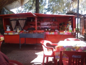 One of the delights in traveling is eating at little roadside stands like this one.