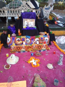 An altar in honor of a recently deceased local baker.