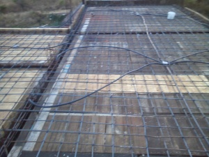 Rebar lain over the wood framing reading for the cement.