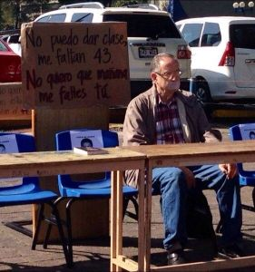The teacher daily set up 43 empty desks in memory of the missing students of Ayotzinapa.