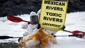 Activists of the environmental organization Greenpeace paddle their KAYAKS in front of Juanacatlan Falls in Mexico, one of the most polluted bodies of water in the country.