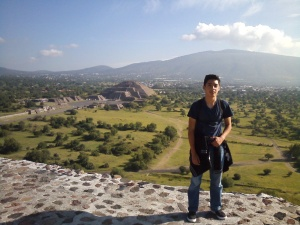 Atop the Pyramid of the Sun with the Pyramid of the Moon in the background at Teotihuacan.